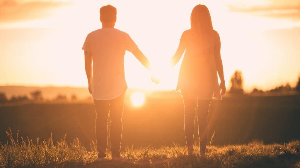 couple in love walk into the sunset